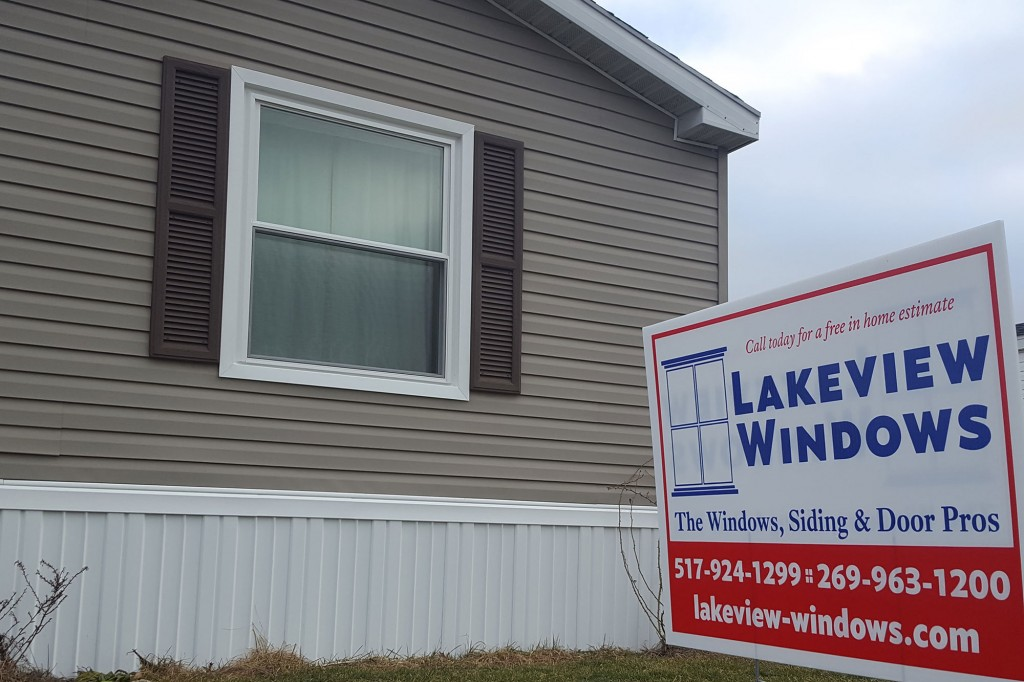 Double-Hung Window and Lakeview Windows & Siding yard sign