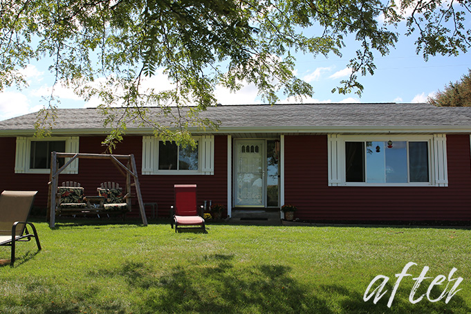 After: Red siding, white door and trim
