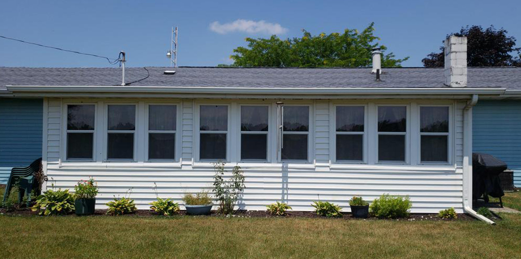 Before: blue and white siding