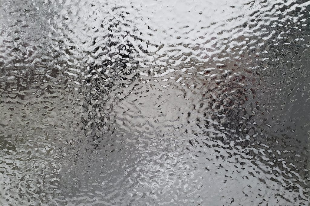 Heavy coating of ice on window